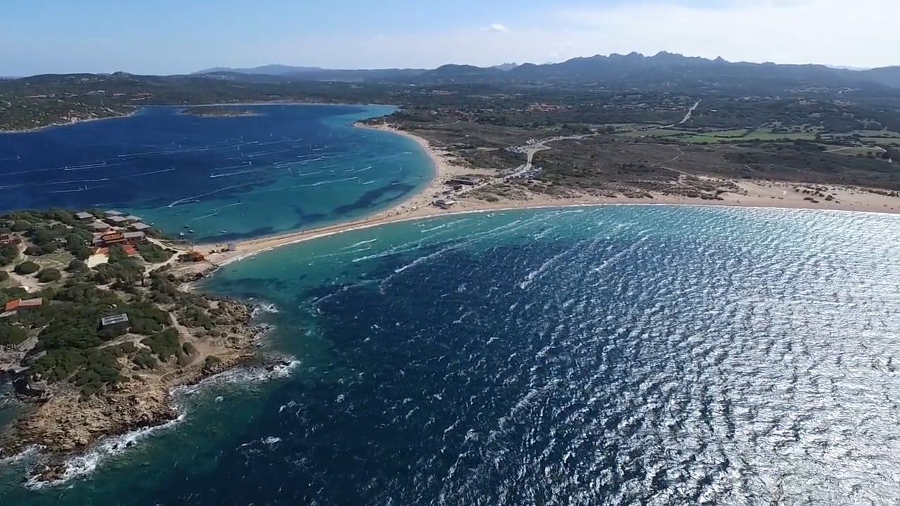 Sardinia Kitesurfing Spots: kitesurfing Porto Pollo, one of the most famous kite spot in Sardinia